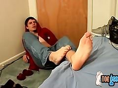 Naughty Bentley jacks off his cock and shows his feet solo