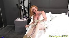 Mature trans beauty stroking her stiff cock
