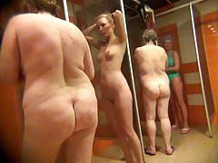 Voyeur girl with smooth body in the women's shower room.