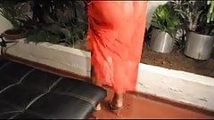 Francys Mutti in orange dress 1-2