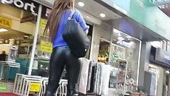 Teen in leather leggings