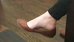 Shoe dangling with pretty foot and arch