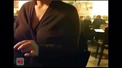Big boobed chick flashes in a public pub 2