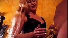 Mistress Amberle, teasing her slaves cock