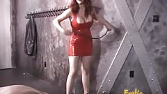 Stunning latex-clad redhead domina has some fun with her man