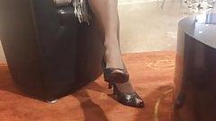 Mature nylon legs and heeled feet