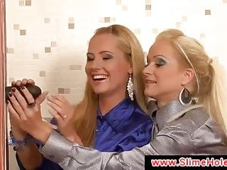Two blondes sucking black dick through a gloryhole