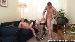 Granny is warming up her cunt before taking in two cock