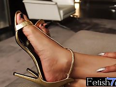 Gorgeous ts ebony Megan Snow is a horny foot fetishist