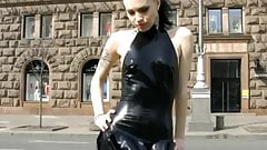 Sexy girl shows her body in latex mini dress and stockings