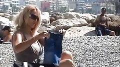 beautiful milf undressing on the beach