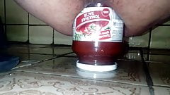 Glass jar and beer bottle in the ass