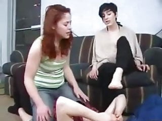 Two girls friend to smell their stinky feet