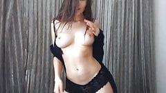 Brunnete dancing in topless in a webcam