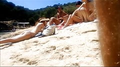 four topless teens at the beach