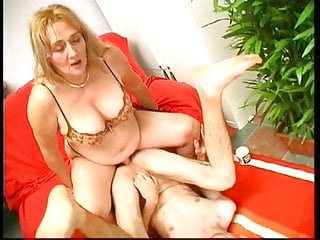 Thick milf with big tits gets guy to suck her strapon cock