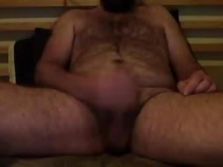 Bearded guy cums and tastes his cum