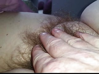 fingers full of soft pubic hair of my wifes pussy