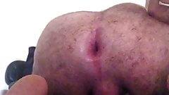 Spreading pinky hole by dildo