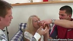 Blonde grandma takes two big cocks at once