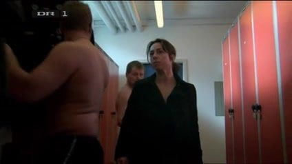 Nude female walks lockeroom in male