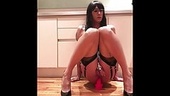 Daisy rides dildo in chastity