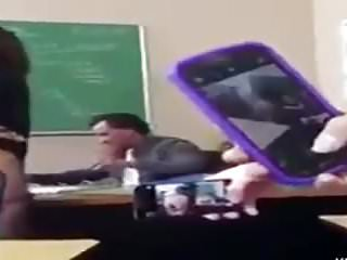 Student Flashing in classroom