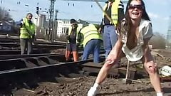 Daring peeing in front of railworkers with hot rear view
