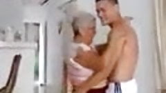latin granny dances with young boy