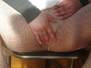 Playing under table in white patterned pantyhose