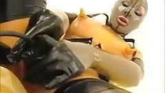 Rubber Lady With Dildo