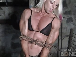 Ripped Female Bodybuilder in Chains Straining Her Muscles