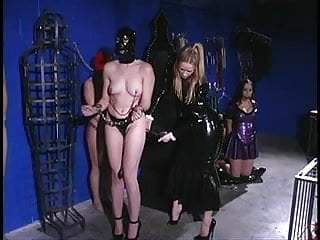 Nicole takes her new slaves into her dungeon