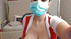 Webcam nurse with mask sucking her nipples