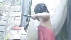 neighbour girl bathing outside in village