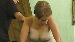 Cute gal with a nice rack spanked by her master