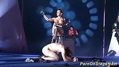 extreme fetish show on public show stage