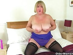 UK milf Melons Marie juggles her big tits and fucks a dildo