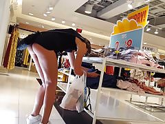 Candid voyeur teen showing ass cheeks while shopping