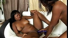 Lusty entertainments of two ebony lesbians on white couch