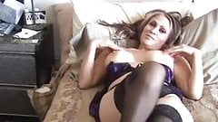 Cougar lies back on the bed and gets her pussy worked and
