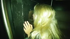 Blond gets her mouth fucked by black cock in the glory hole