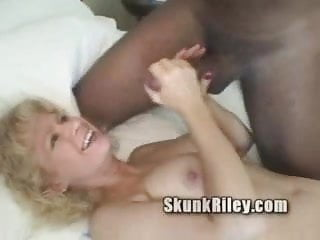 Big fake titty blonde Robin takes Skunks big black cock