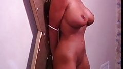 Big tits blonde bound and hooded, with wax on her boobs