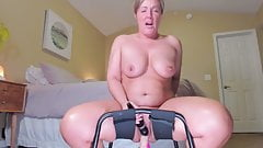 Beautiful mature bouncing on a dildo