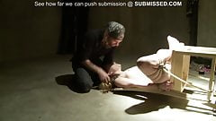 Tied girl is to suck and play with a dildo by sub