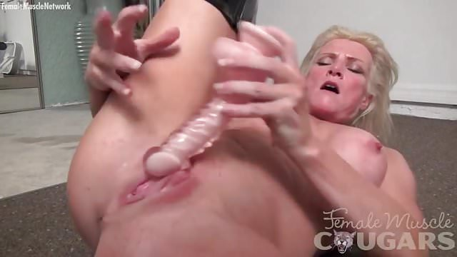 Preview 1 of Muscular cougar Mandy Foxx is masturbating in sexy boots