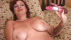 Hot redhead with nice big tits spreads and toys her tight pussy