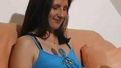 German mom fingers her moist pussy