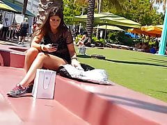 Candid voyeur girl sitting with back of shorts unzipped